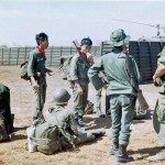 ARVN infantry at Blackhorse during a refueling stop - with one of our Sargents